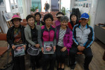 Author with a group of haenyeo, including Im Seong-ok (right)--one of the few male divers on Jeju Island. Middle front row: Cho Jeong-sun, one of the haenyeo of Sagye village.