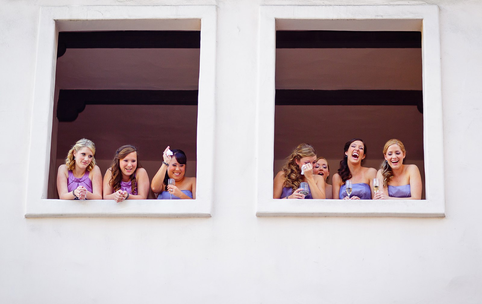 bridesmaids-laughing-while-bride-sees-groom-for-the-first-time