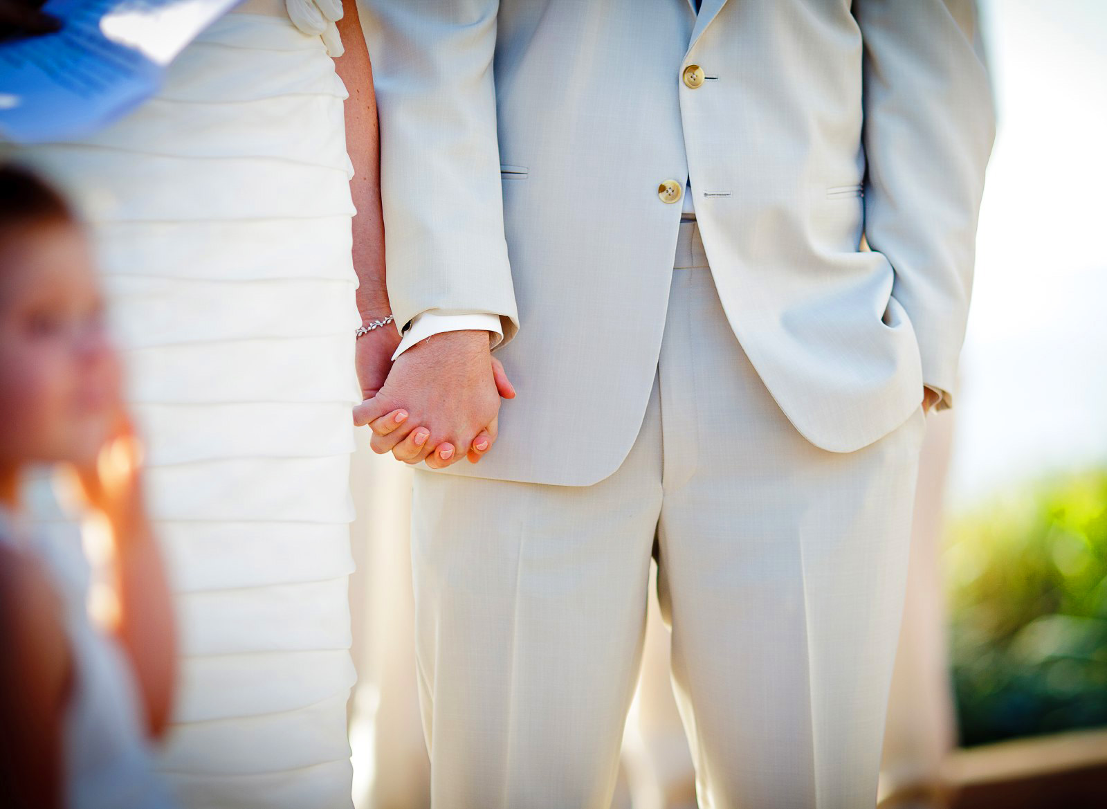 close-up-bride-and-groom-hands-wedding-ceremony