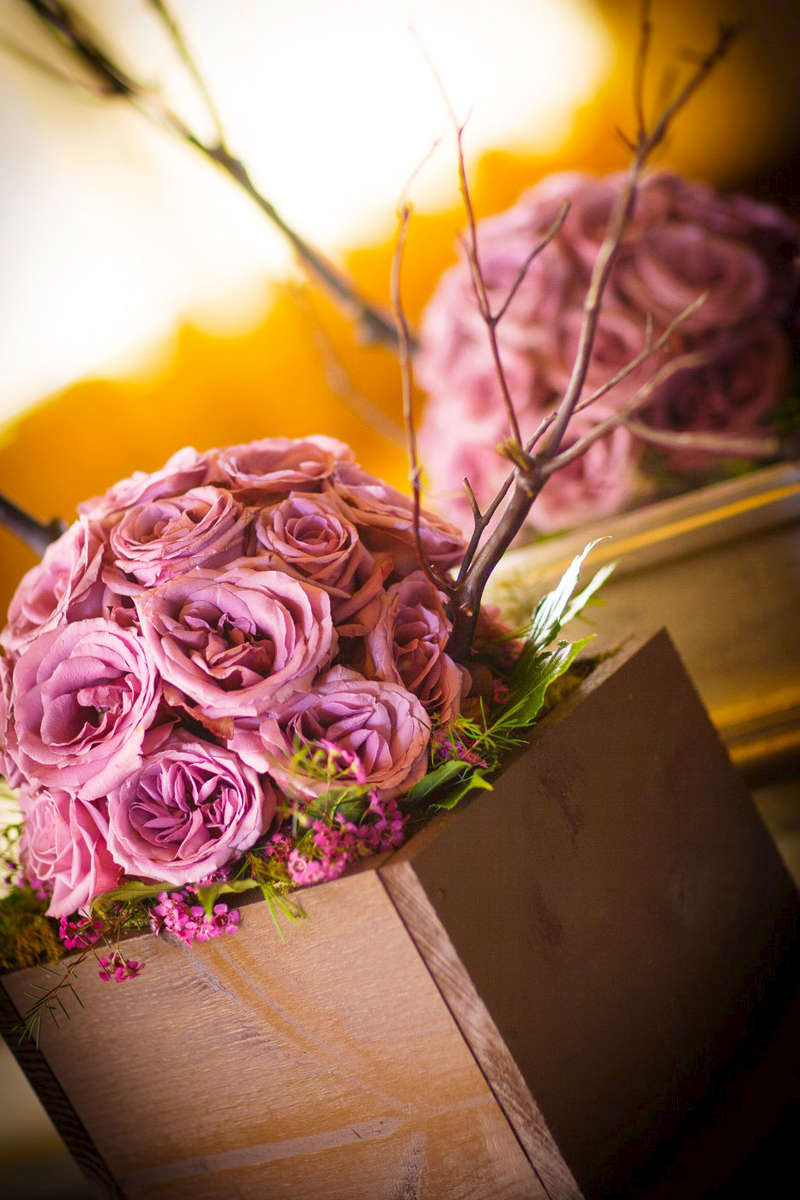 close-up-of-purple-roses-in-brides-bouquet