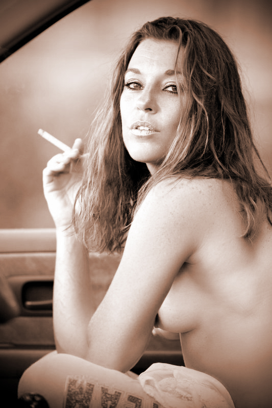 Classic...  Homage to the old Virginia Slim commercials from the 1970's;  pretty woman taking a smoke break, a true dose of sponteneity got us where we wanted to be with this shot. There you have it in a nutshell.