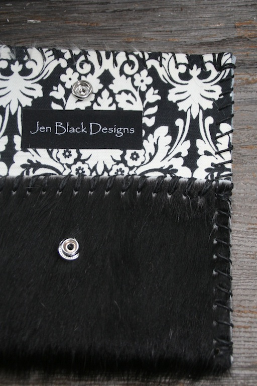 Black Brazilian Hair-on Cowhide with a Black & White cotton floral lining