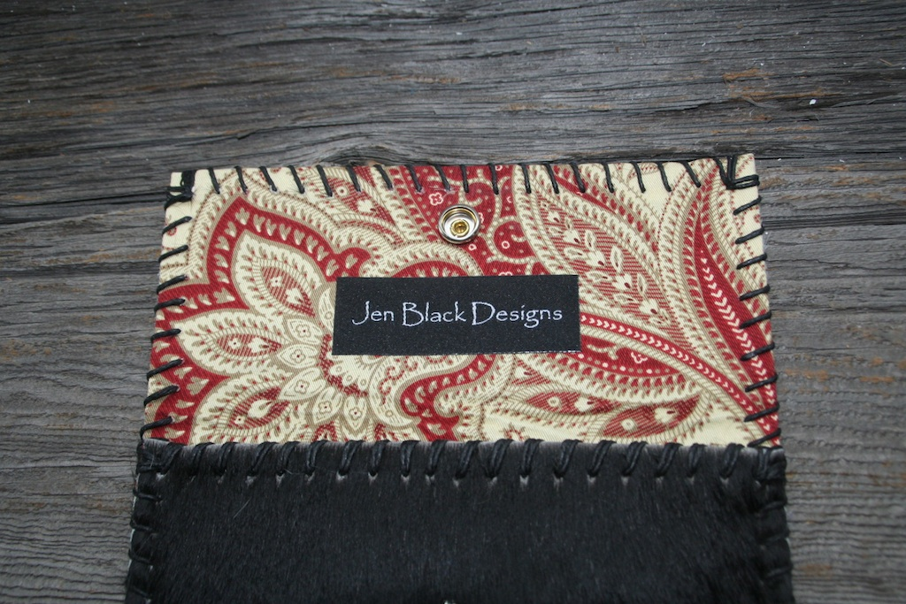 Black Hair-on Cowhide  with a Yellow & Red Paisley Print Lining