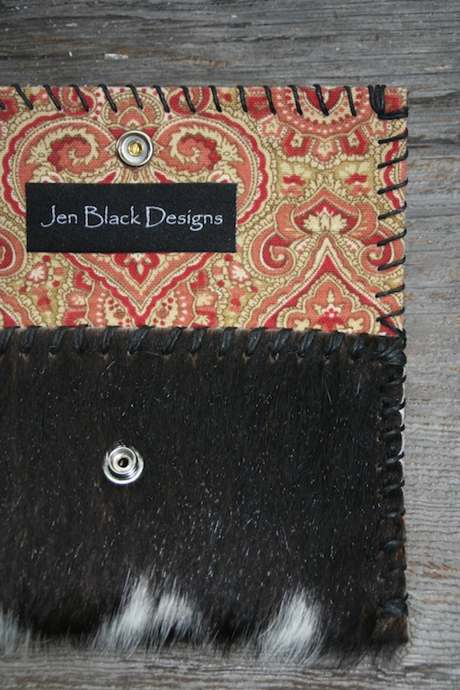 Black & White Hair-on Cowhide with an multi-red paisley cotton lining