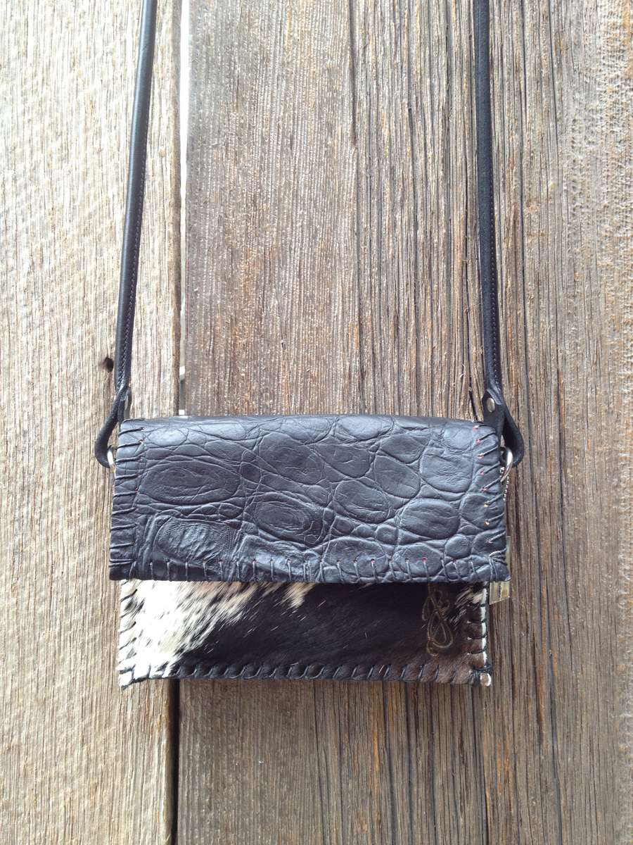 Black Croc Embossed Leather paired with a Black & White Brazilian Hair-On Cowhide front panel.Black Amish Horse Bridle Strap