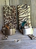 Printed Animal Print Hair-on Cowhide Clutch and belts with artisan hand forged buckles