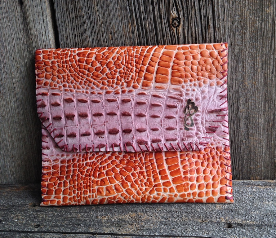 A Colorful Orange and Purple Croc Embossed Leather, opens to a pounce of more color!