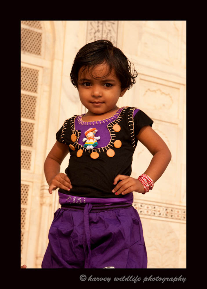 This child was enjoying a day at the Taj Mahal with her little brother and her parents. After giving us permission to photograph them, this little ham got right into posing like a Ballywood Star.