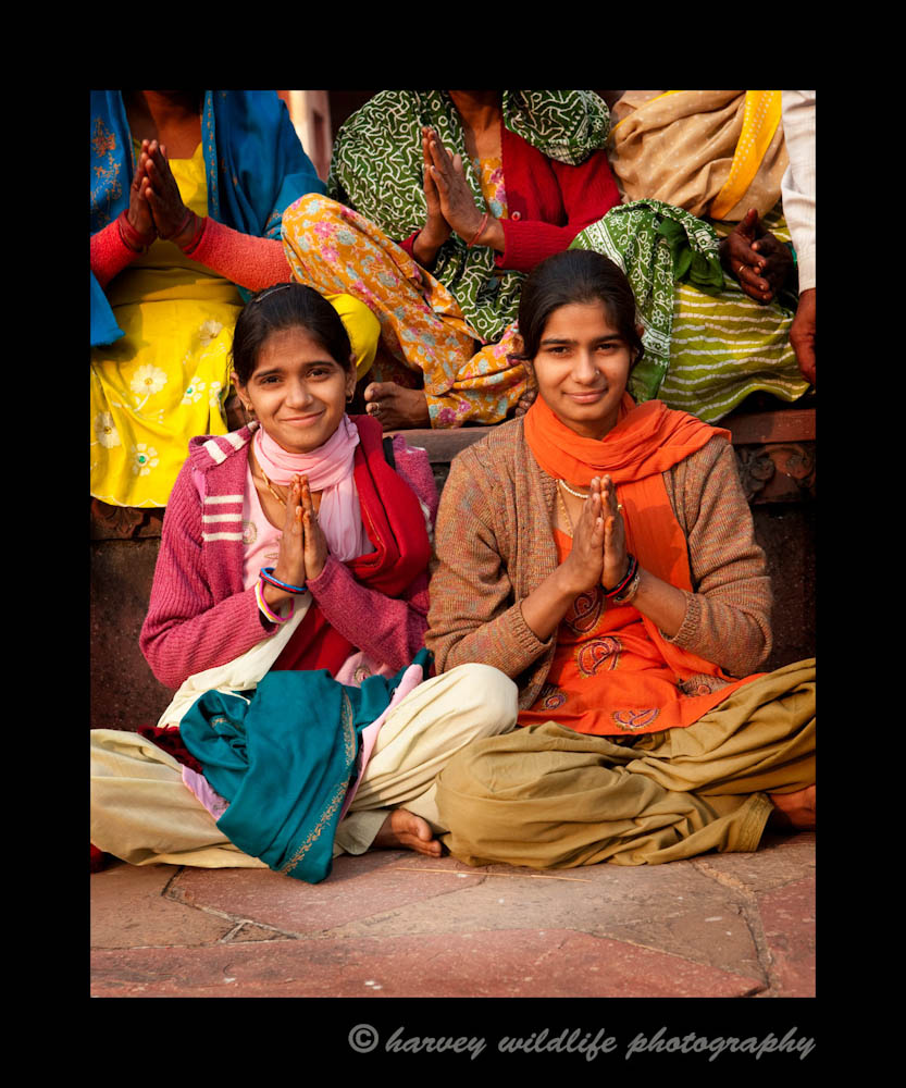 These two teenage girls were posing as part of a large family group. Their expressions were too good for me to pass up, so I took a few pictures of just them. I love the colours of the clothing in this group. I wish I could find them again, so I could send them this picture.
