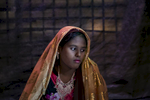 Farmina Begum, 16, is seen on the day of her wedding to 18 year old Hashimullah, in a Bangladesh refugee camp in Cox's Bazar, Bangladesh. Farmina and her family fled on August 25th after the military attacked their village of Kullung. The military came to their village and burned houses and shot people. They hid in the hills for 8 days and spent 5 days walking to the Bangladesh border. Hashimullah and Farmina met at the water pump in the Bangladesh refugee camp near their home and he proposed to her father and he agreed to the marriage. Farmina's mother says 'When we got his proposal we agreed because we don't enough food to feed her. If she got married, she would then be her husband's responsibility. She's getting older and and older girls shouldn't be single.'