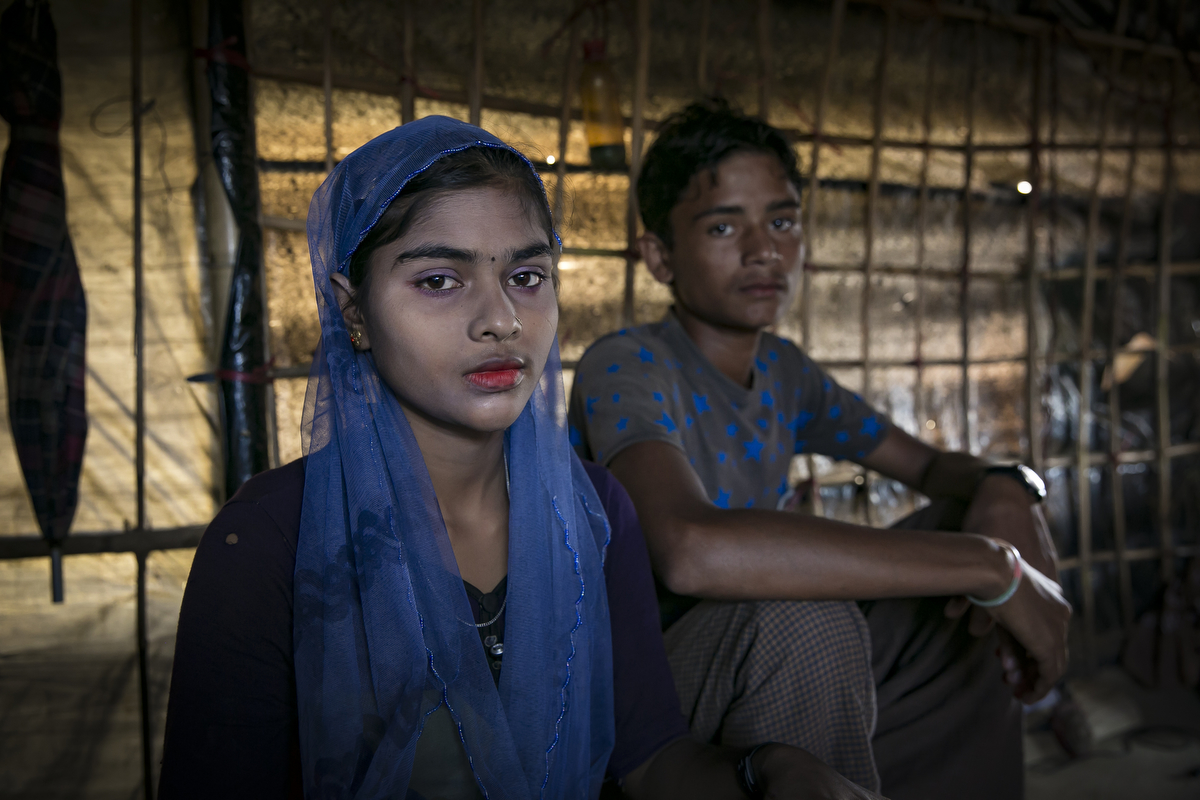 Tasmina Begum, 16, and Mohammad Eliyas, 18, pose for a photo in Cox's Bazar, Bangladesh. They married in a Bangladesh refugee camp 4 days ago. They fled after the August 25th attack when the military came to their village, burning houses and raping women. Eliyas says 'My parents are very old and have no one to take care of them and have no one to cook for them, so they decided I should get married. I'm a man, how can I cook? It was my parents decision that I should marry her, it's no problem that she's young. I have to do what my parents say.' Tasmina says, 'My father wanted me to get married so I couldn't say no.'