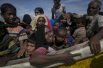 Rohingya are seen after arriving on a boat to Bangladesh