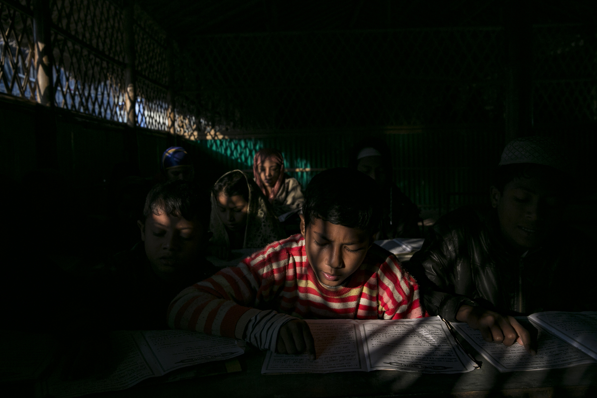 Rohingya refugee study the Koran at a school in Balukhali camp