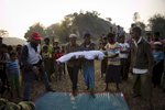 The bodies of Rohingya refugee are carried for burial in Balukhali camp in Cox's Bazar, Bangladesh. 30 year old Nurhaba, 8 year old Amin Sarif, 5 year old Dilsan Bibe and 1.5 year old Arjunan died in the late night of January 11th when their tent in a transit camp caught fire. Their family arrived in Bangladesh 3 days ago from Rasidong, Myanmar. They left their village 18 days ago after the Myanmar military and local Buddhist beat Nurhaba's husband, Adbul Rahim, and refused to let him harvest his fields. For 15 days they walked to the border and took shelter in other villages, with hardly enough food or water to sustain them along the way. When they were finally able to cross over into Bangladesh by boat, Abdul Rahman said they felt happy and confident about their future.