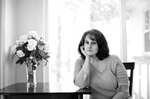 """Lisa, a 45-year-old writer, poses for a portrait in her home in, Massachusetts. Lisa says she became pregnant and had two abortions when she was in her 30′s. """"His immediate response was 'Well you can't have it!' It was such a fast and such a visceral response that he had. I asked him why and he said 'Well you just have to get an abortion… you can't have this baby and there's no way around it,"""" Lisa said. """"All I kept hearing was, 'I will never love you and I will never love this baby.' … When I looked down the road five years, 10 years, 15 years, 20 years, I didn't see any happiness in this child's life. I wanted the baby. I knew that I could love it and I could give it certain things, but hate is a powerful emotion to overcome in a child's life. Not being wanted is a very powerful emotion in a child's life. You can do a lot of damage to a child with that feeling. I couldn't inflict that kind of pain on a child – knowing what that felt like… So I agreed to terminate the pregnancy… After some while… I said 'Look, if you didn't want children you should have controlled your – fully controlled – your reproduction.' And that's what upsets me so much about when I hear the abortion debate now, is that I don't hear any part of that at all – there's nothing about men needing to control their reproduction. Because it's almost like women enjoy having abortions. It's like it's a cavalier decision,"""" Lisa said. """"We've been conditioned that there's a certain kind of woman that has an abortion. You know, that it's poor women who have abortions, who just don't want to control their reproductive rights and that those women who have abortions – it's not the more common thing where it's women who do control their reproductive rights. But, things happen. Nothing is 100%. And when nothing is 100% you will have an unplanned pregnancy. I've been in there with married couples, who had too many children and were deciding to terminate because they had four kids or something. And they thought t"""
