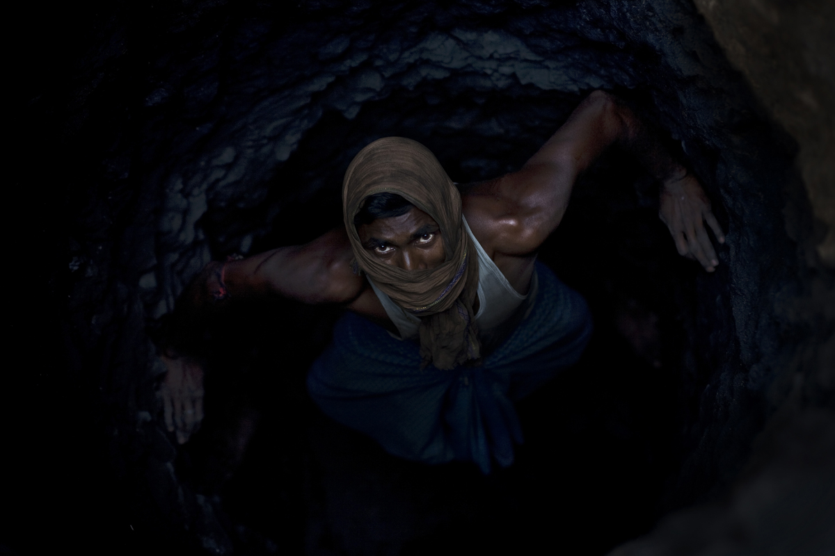 A man crawls through an underground mine in Jharia.