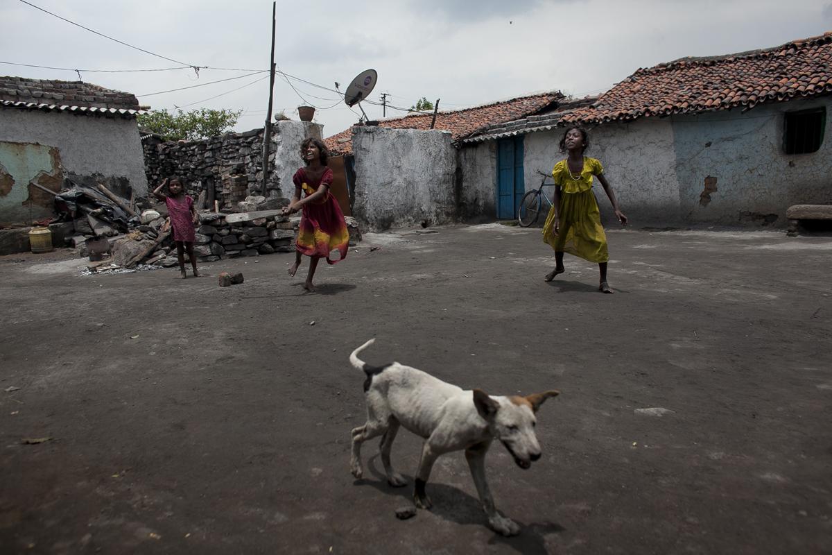 Young girls in a village near Jharia play a game of cricket.