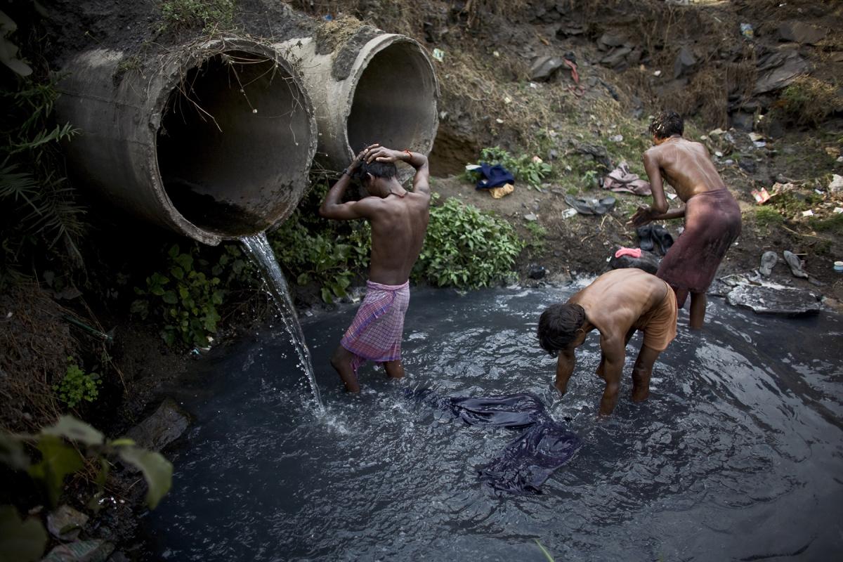 People bathe in Jharia.