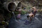 People bathe in Jharia.