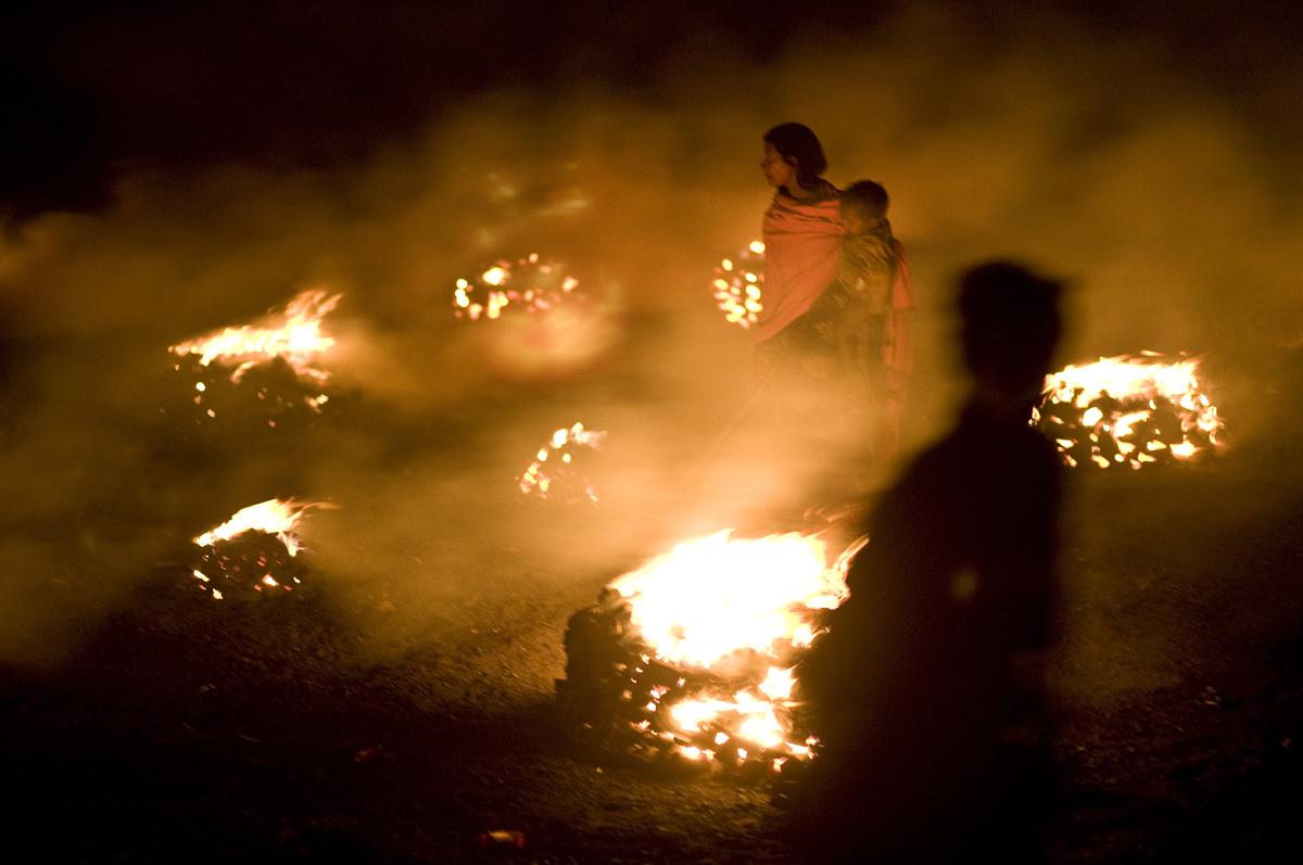People burn coal in Bokahapadi Village, Jharia.