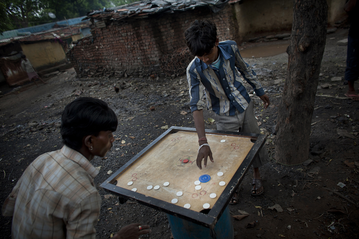 Residents play a game in a village near Jharia.