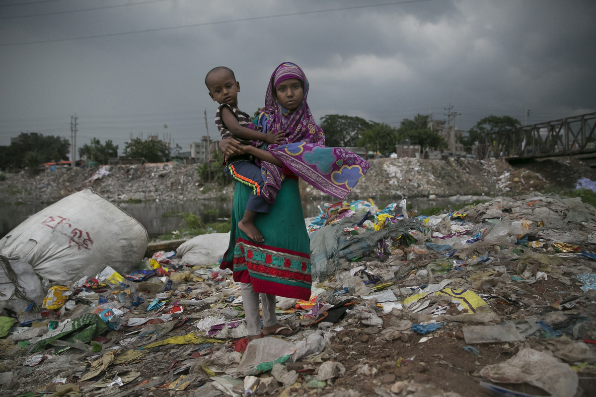 A girl holds a baby outside a plastic factory situated along a canal that leads to the Buriganga river in Dhaka, Bangladesh. Bangladesh has been reportedly ranked 10th out of the top 20 plastic polluter in the world with the Buriganga river known as one of the most polluted rivers in the country due to rampant dumping of industrial and human waste. Like many developing countries, Bangladesh lacks the infrastructure to effectively manage their waste which causes problems in keeping the waters safe for human and aquatic lives while dozens of tanneries on the banks of the river contribute industrial waste into the ground water. As June 5 was marked by the United Nations as World Environment Day, Buriganga symbolizes the general state of many rivers in Bangladesh, with the growing levels of pollutants and plastic waste consuming up all oxygen in the river and affecting our seafood while fishes consume bits of plastic which mimics their natural food sources and eventually lands on our dinner table.