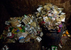 Overflowing buckets of used condoms are seen in a brothel in Bangladesh