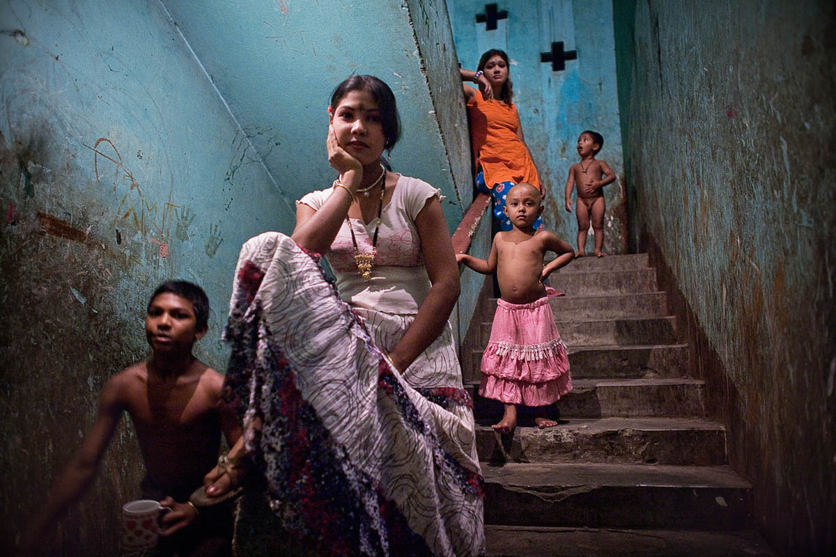 Young chowkri (bonded sex workers) wait for customers in the stairwell of the 3rd floor in the Joinal Bari brothel.