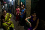 Joshna, a madame, and her girls wait for customers in a brothel in Bangladesh. {quote}I was raised in Gaibandha and was married , but my husband divorced me after my family could not pay the expensive dowry he demanded, nor could they afford to keep me. It was through desperation that I found this brothel, which has been my home for 16 years.  After spending four years as a sex worker, I became a madame. How can I be happy in this hell? I will be happy when I leave this place.{quote} Joshna has plans to move to Dubai as soon as she can.