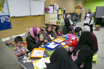 Rohingya women, children and volunteers participate in a {quote}Mommy and Me{quote} class at the Rohingya Cultural Center of Chicago on January 10, 2019 in Chicago, Illinois. The Mommy and Me class teaches children structured play, mothers how to bond with their children and prepare them for school.