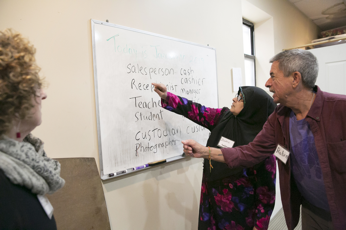 Rohingya refugee Zulah participates in an English class at the Rohingya Cultural Center of Chicago on January 10, 2019 in Chicago, Illinois. Zulah was resettled in Chicago in 2014. She fled Myanmar after the military killed her husband, taking a boat to Thailand and then traveling overland through the jungle with no food or water to Malaysia. She has two daughters who are still living in Myanmar, and often tell her of the violence and harassment they are experiencing.