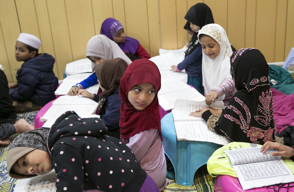 Children participate in a Koran class at the Rohingya Cultural Center of Chicago