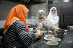 Rohingya refugees Aisha and Naznin work at their mother's restaurant, the Tea Leaf Garden restaurant on January 11, 2019 in Chicago, Illinois. In 2018 Rohingya refugee Nasimah and her friend opened the Tea Leaf Garden restaurant, which serves halal Rohingya, Malaysian and Burmese food. Nasimah escaped violence and oppression in Myanmar in 1977 to Malaysia and was resettled with her family in Chicago in 2012. Her son Mohammad says that {quote}Everything is better here in the US. We are able to go to school.{quote}