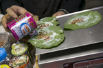 Nooraisha prepares paan leaf for customers at the Shwe Myanmar Grocery Store on January 11, 2019 in Chicago, Illinois. Nooraisha and her family escaped violence and oppression in Myanmar in 2000 to Thailand and then Malaysia, and was resettled in Chicago in 2010. She opened the Shwe Myanmar Grocery Store in 2017, and stock many products from Myanmar.