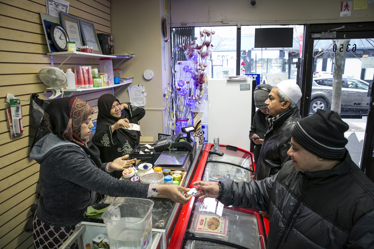 Nooraisha and her husband Jahangir work at their shop, the Shwe Myanmar Grocery Store on January 11, 2019 in Chicago, Illinois. They escaped violence and oppression in Myanmar in 2000 to Thailand and then Malaysia, and were resettled in Chicago in 2010. They opened the Shwe Myanmar Grocery Store in 2017, and stock many products from Myanmar.