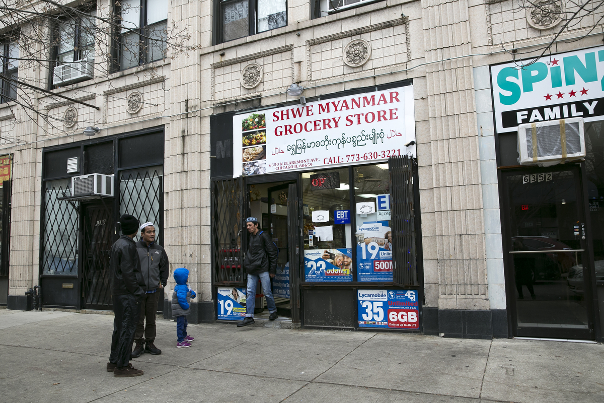 Customers are seen outside the Shwe Myanmar Grocery Store on January 11, 2019 in Chicago, Illinois. Nooraisha and her family escaped violence and oppression in Myanmar in 2000 to Thailand and then Malaysia, and was resettled in Chicago in 2010. She opened the Shwe Myanmar Grocery Store in 2017, and stocks many products from Myanmar.