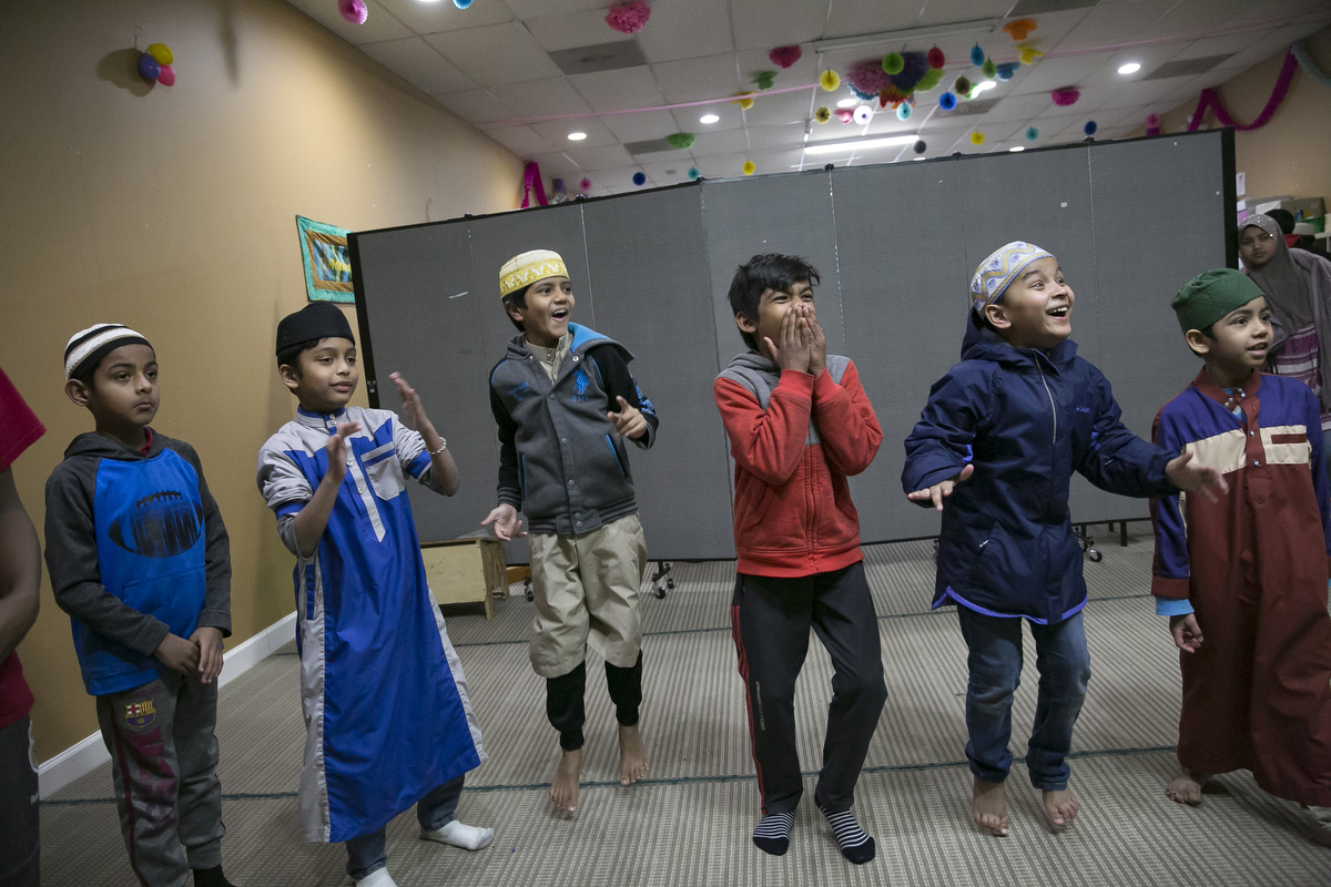 Children play at the Rohingya Cultural Center of Chicago