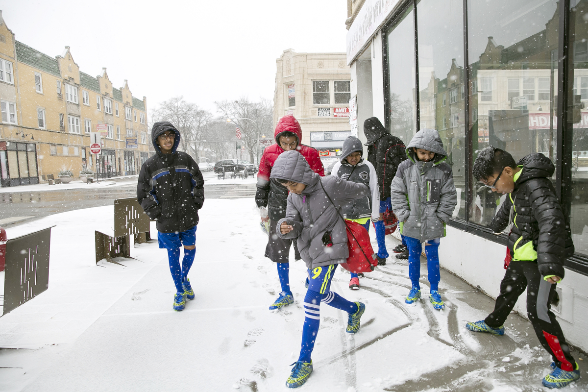 Rohingya soccer players play in the snow while traveling to a game