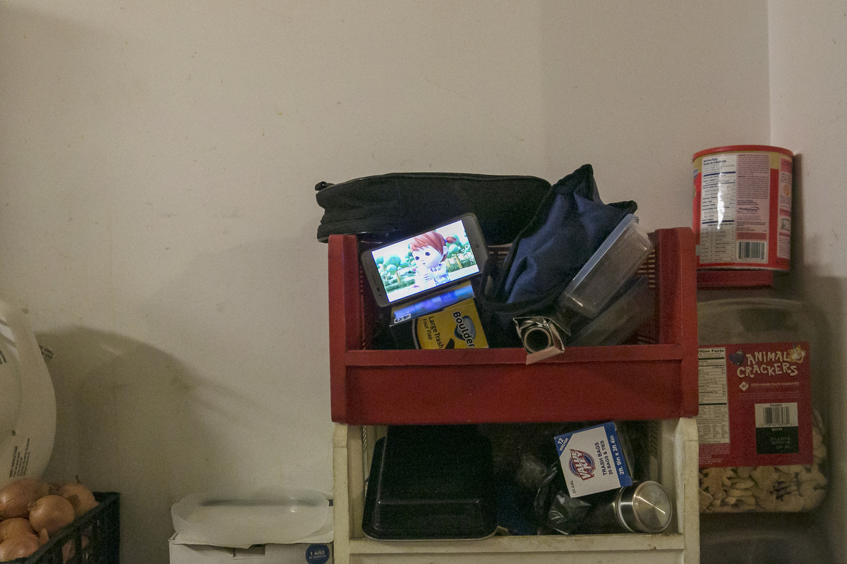 A phone plays a tv program in the Shukor family home
