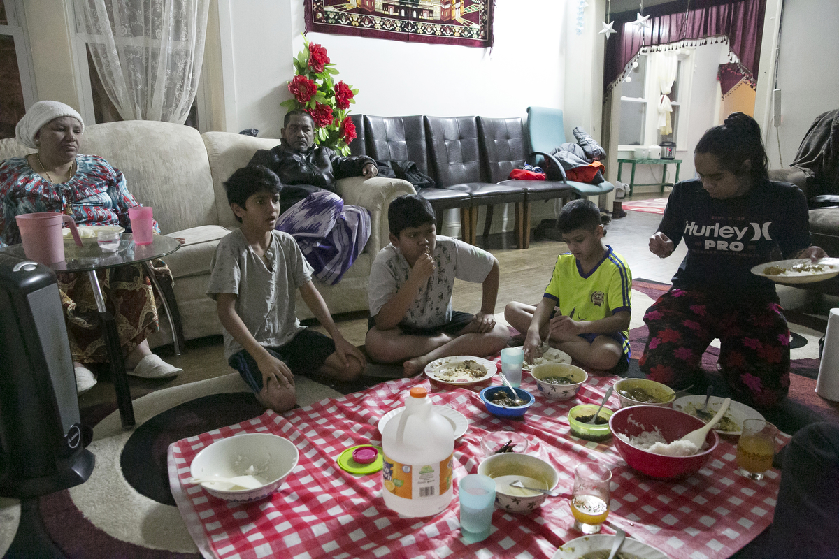 The Shukor family eats dinner on January 12, 2019 in Chicago, Illinois. The Shukor family arrived in Chicago in 2014 from Malaysia. Mohammad Shukor fled Myanmar in 1978 after the military shot him and arrested his father, who died in jail. He fled to Thailand by boat and spent 5 years there before making his way to Malaysia with his family. In Malaysia he and his family were denied an education, had to work illegally, and were frequently arrested and harassed by authorities. When he and his family were resettled in the US he says he {quote}felt so happy to finally have a country, to finally have a place to call home{quote}.