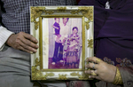 Mohammad Shukor and his wife Noor Jahan hold a photograph of themselves with two of their 11 children, taken in Thailand in 1980, on January 12, 2019 in Chicago, Illinois. The Shukor family arrived in Chicago in 2014 from Malaysia. Mohammad Shukor fled Myanmar in 1978 after the military shot him and arrested his father, who died in jail. He fled to Thailand by boat and spent 5 years there before making his way to Malaysia with his family. In Malaysia he and his family were denied an education, had to work illegally, and were frequently arrested and harassed by authorities. When he and his family were resettled in the US he says he {quote}felt so happy to finally have a country, to finally have a place to call home{quote}.