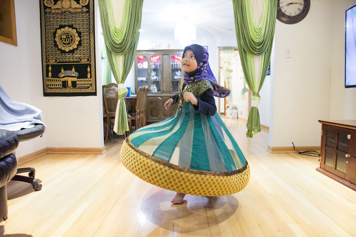 5 year old Azrina plays in her home on January 12, 2019 in Chicago, Illinois. The Shukor family arrived in Chicago in 2014 from Malaysia. Mohammad Shukor fled Myanmar in 1978 after the military shot him and arrested his father, who died in jail. He fled to Thailand by boat and spent 5 years there before making his way to Malaysia with his family. In Malaysia he and his family were denied an education, had to work illegally, and were frequently arrested and harassed by authorities. When he and his family were resettled in the US he says he {quote}felt so happy to finally have a country, to finally have a place to call home{quote}.