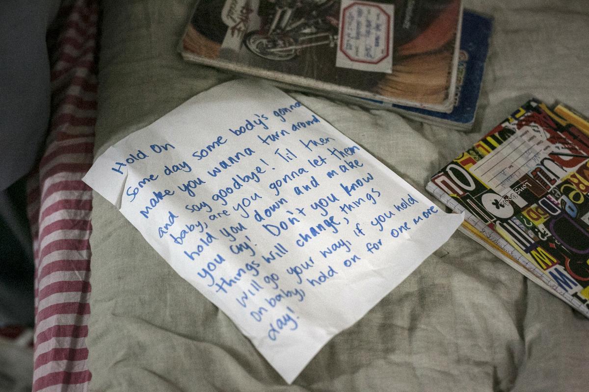 Lyrics copied by Nikarika, 17, lie on a bed before school at the Veerni Institute