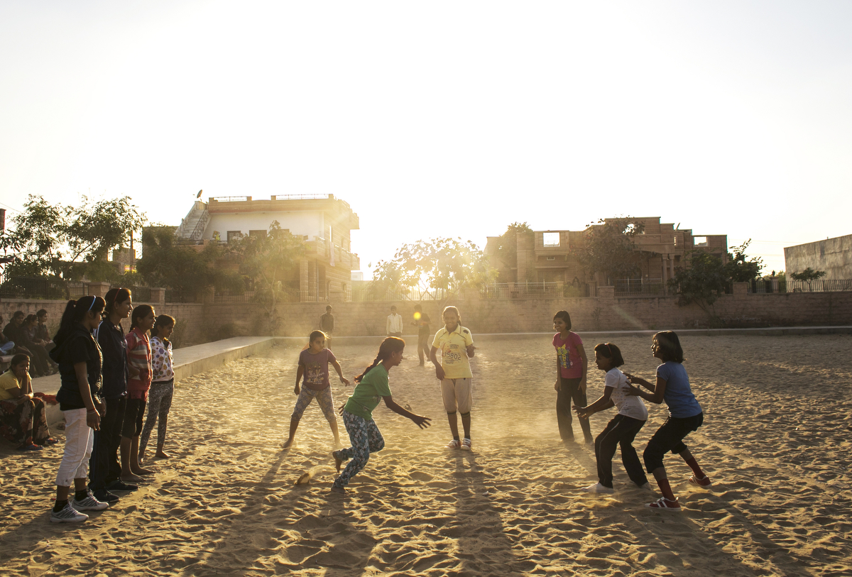 Girls play kabaddi in a field near the Veerni Institute