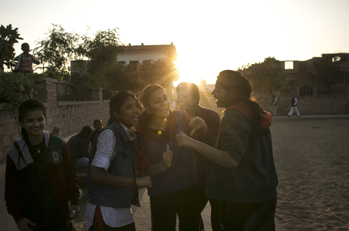 Nikarika, 17, (in red sweatshirt and yellow headband) cheers on her friends playing kabaddi near the Veerni Institute