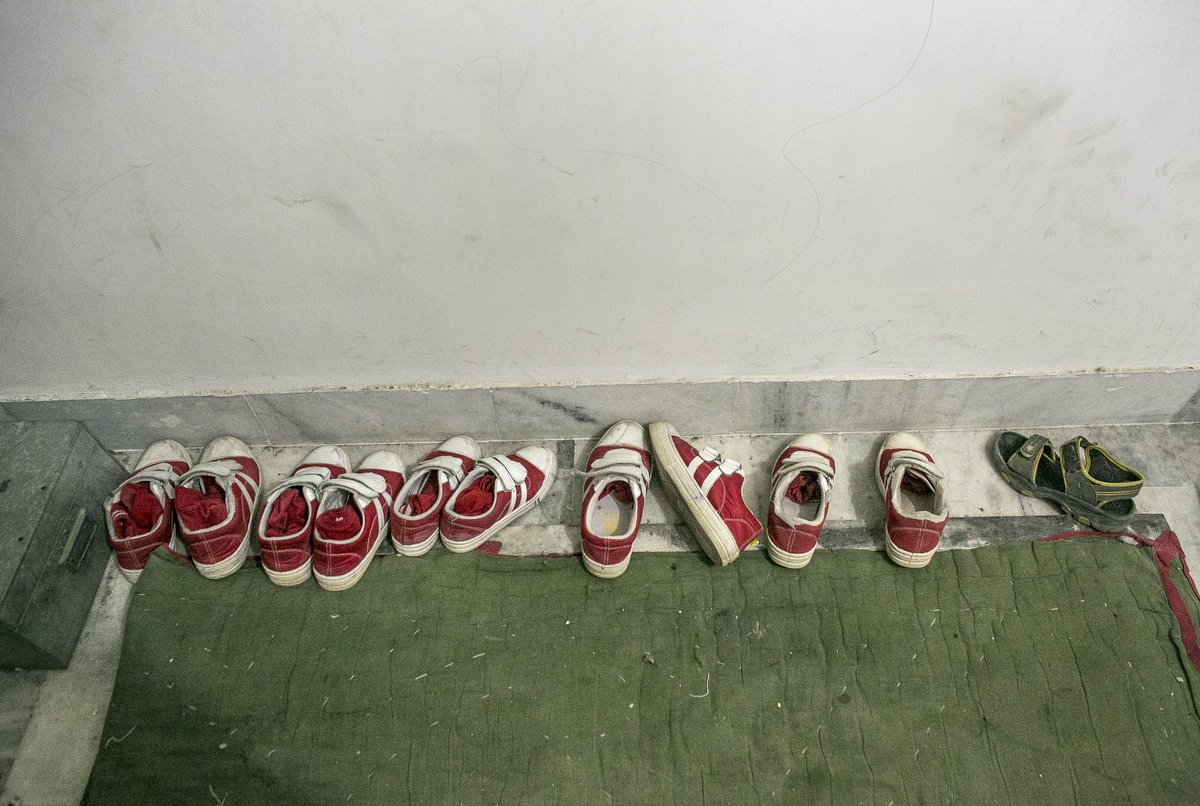 Girls shoes are lined up before school at the Veerni Institute