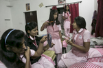 Girls prepare for school early morning at the Veerni Institute.
