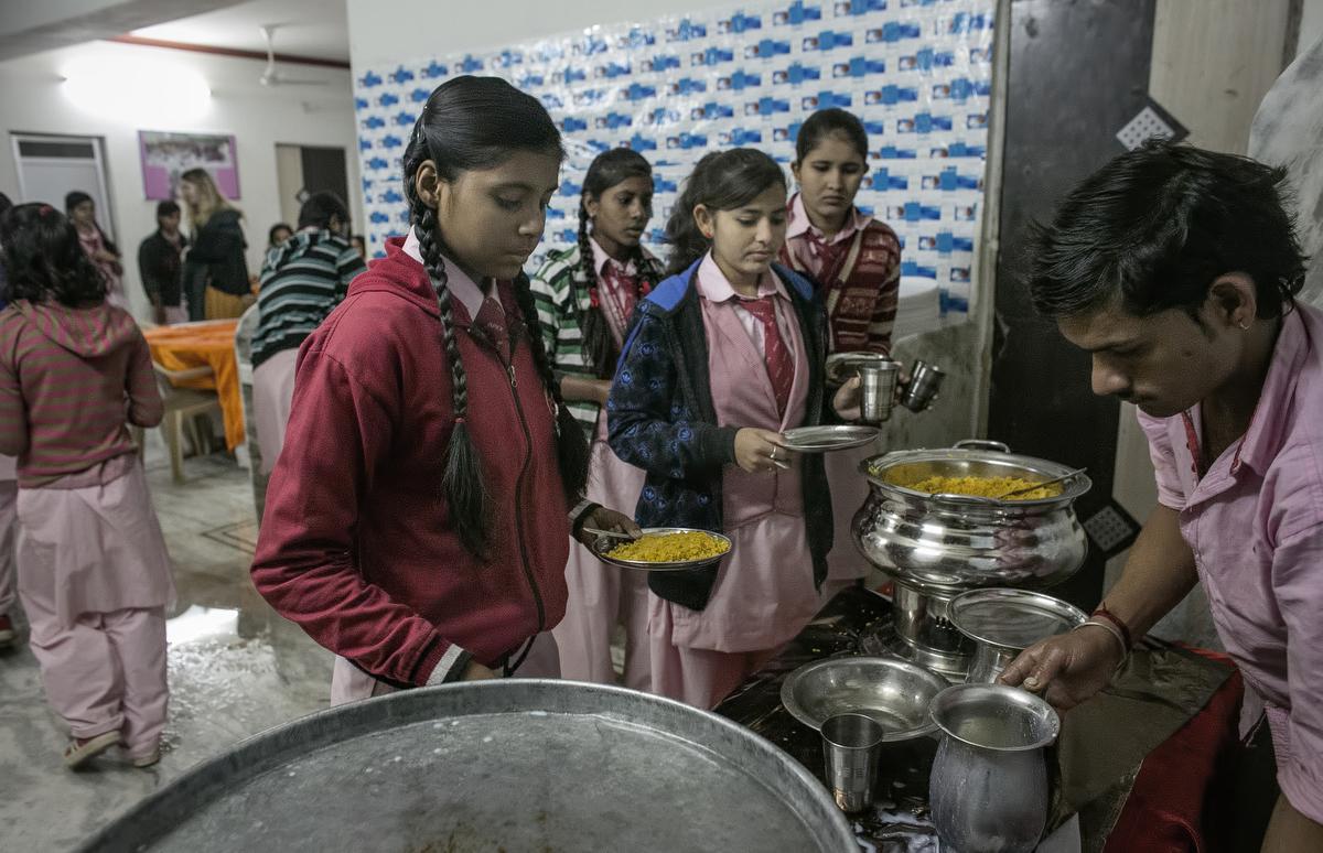 Worship gets breakfast before school at the Veerni Institute