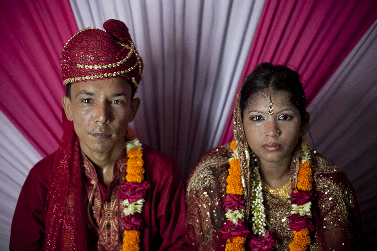 13 year old Runa Akhter sits next to her husband, 29 year old Zahrul Haque Kajal, the day of her wedding, Runa was in the 7th grade, and loved reading, sports and traveling. She wanted to wait until she was 21 to get married but, {quote}No boy want's to marry a girl older than 18 in my village{quote} she said.