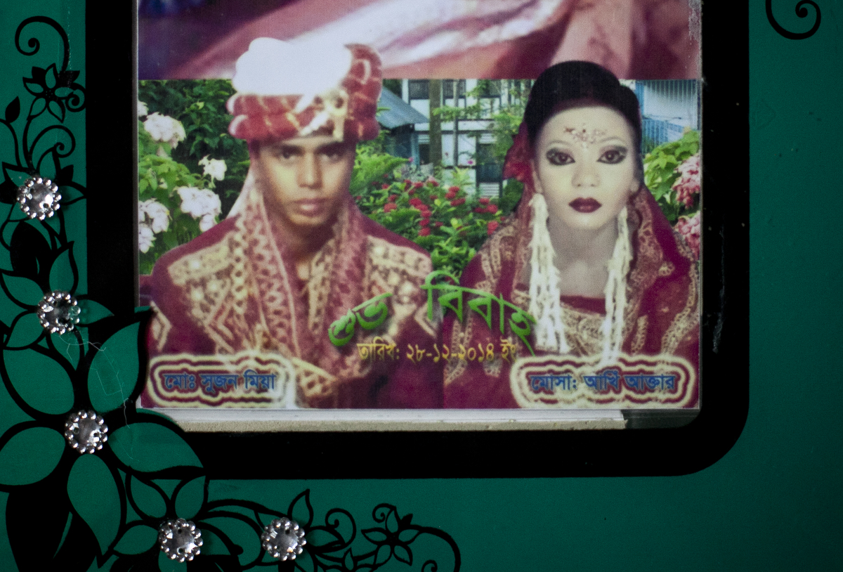 27 year old Mohammad Sujon Mia and his wife, 14 year old Mousammat Akhi Akhter, are pictured in their wedding photo. Last year, when she was only 13, Akhi got married a 27 year old man. She had finished 6th grade and wanted to wait until she was older to get married, but she says her parents felt social pressure to marry her young.